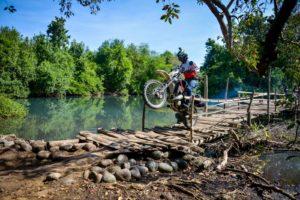 Dirt Bike Wheelie across a bridge