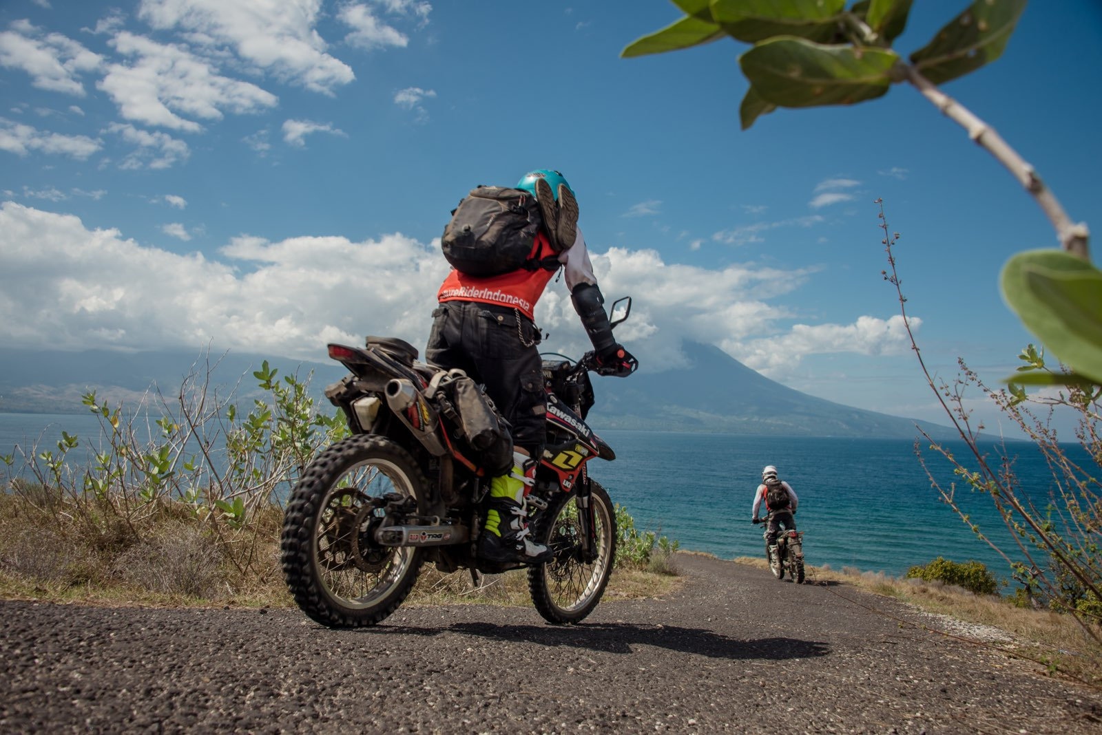 Adventure riders riding along the coast to Bajawa
