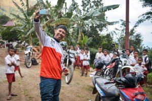 A local village school in East Nusa Tenggara welcomes the adventure riders
