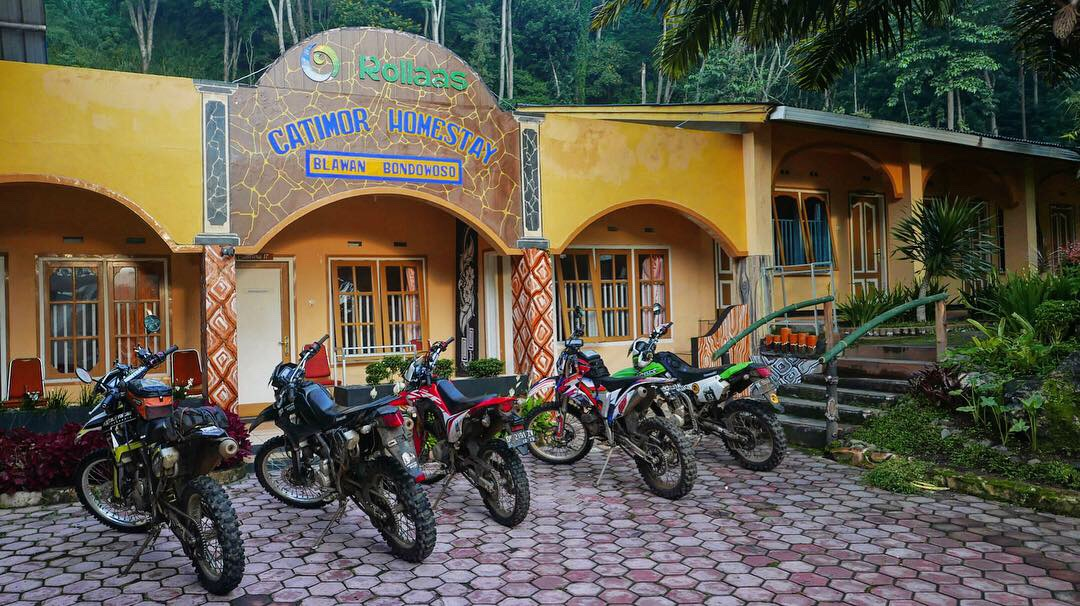 The Enduro Motorcycles are parked in front of the Catomor Homestay inside Wurung crater