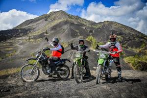 Riding the Kawasaki KLX250s in Bali while visiting the black eruption site in Kintamani