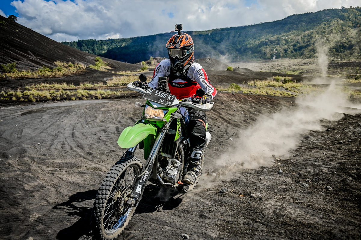 Kicking up some dust is part of the fun on the dirt bike tour to Mount Batur black lava field in Bali