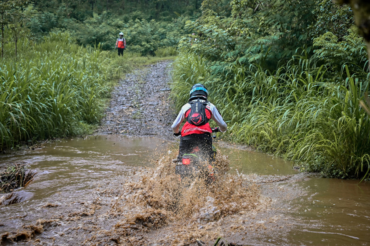 Crossing a small river in East Java on the way to Mount Bromo
