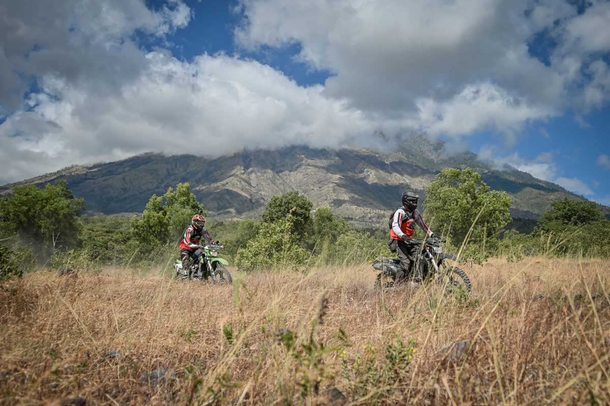 Dirt Bike riders passing Mount Agung Volcano